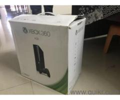 XBOX 360 E with 6 games for SALE
